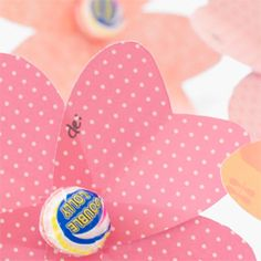Make favours or little valentine gifts with simple heart flowers and sweet lollipops