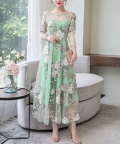 Romance abounds in the details of this dress decked out in intricate floral embroidery, and a seamed waist provides a flattering fit.
