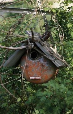 Vintage can birdhouse