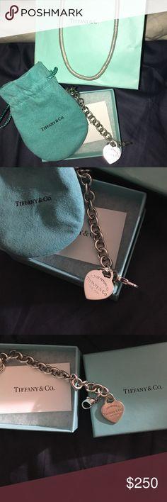 Tiffany & Co. Return to Tiffany bracelet Used, authentic Tiffany and Co. Return to Tiffany bracelet with storage/cleaning bag, original box, bag and bow. Tiffany & Co. Jewelry Bracelets
