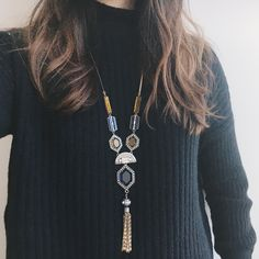 Your go-to cozy sweater just got a major dose of festive chic with the gorgeous Grand Cabaret Convertible Tassel Necklace!