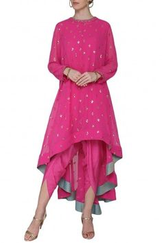 Vvani by Vani Vats Featuring a pink asymmetrical kurta in georgette base embellished with sequin hand embroidery and brocade inline borders. It is paired with dhoti pants in crepe base. Tunic Designs, Kurta Designs Women, Pakistani Outfits, Indian Outfits, Pink Colour Dress, Pink Dress, Indian Designer Suits, Indian Dresses, Indian Wear