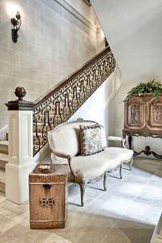 Faux stone? most likely. So well done, beautiful neutral color palette used here. Blayne Beacham Interiors