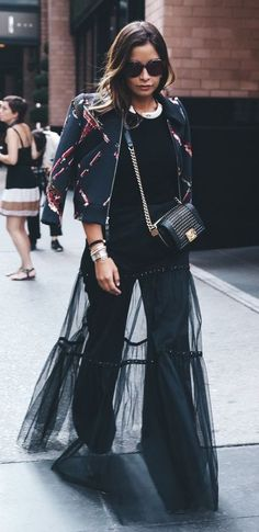 sheer maxi over jeans. chic street style.