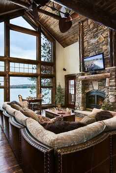 A snowy retreat in the mountains can be very cozy nestled in your cabin style living room with a roaring fire, warm colors and cozy fabrics and artwork.