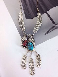 Old Native American turquoise necklace - stunning. Turquoise, coral, feathers and leaves. A personal favorite from my Etsy shop https://www.etsy.com/listing/278771120/vintage-native-american-navajo-turquoise