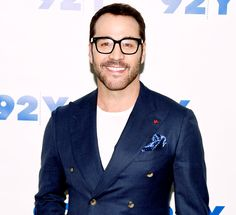 Jeremy Piven white crew neck tee + navy jacket casual combo.