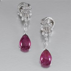 PAIR OF PENDENT RUBELLITE AND DIAMOND EARRINGS Each suspending a cabochon rubellite drop from a marquise-shaped diamond, to a stylised knot ...
