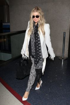 Pin for Later: Airport Chic: These Celebrities Know How to Travel in Style Fergie