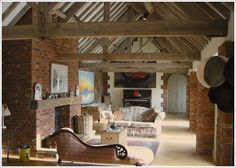 Barn conversion - love the raw brick, the beams, and the corrugated iron ceiling.