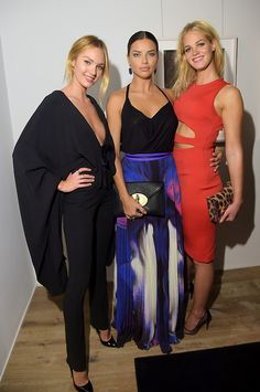 """runwayandbeauty:  Candice Swanepoel, Adriana Lima and Erin Heathertonattend Russell James' """"Angel"""" book launch hosted by Victoria's Secret on September 10, 2014 in New York City."""
