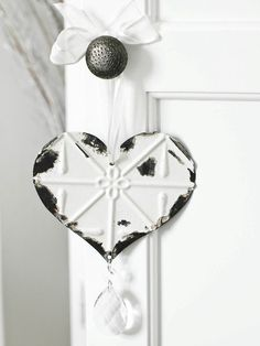 I love hanging things from door knobs ... all this heart needs is a little bell or some chimes.