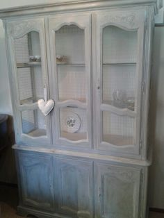 Chicken wire really gives a French feel to this Repro unit.  Amazing what a lick of paint can do.  www.vintro.co.uk