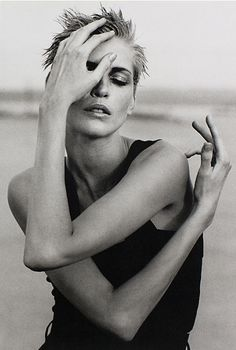 I like poses where the face is deliberately obscured.  by peter lindbergh