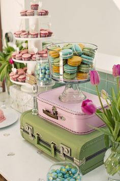 Love the stacked suitcases. And colorful macaroons are always a hit! #sweetstable
