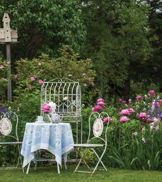 A Victorian- style bistro set is dressed for afternoon tea.