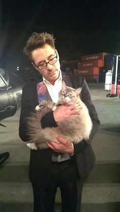 Robert Downey Jr with a cat. I knew I loved him!!