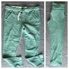 Mint Green Cotton Pants  NWT KIIND OF Mint Green Pants with detailed seems in front and back. 95% cotton 5% Elastine. Drawstring waist and elastic waist. Zipper front pocket detailing. Kiind Of Pants