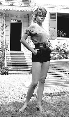 A young Brigitte Bardot at her family's country home in Louveciennes, just outside Paris. Mid-1950s.