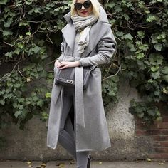 <on the move again ✈️ Wearing my @michellewaughny Harper coat!>