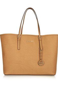 MICHAEL Michael Kors. Think I just found my next purse. :D