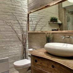 Check out this #rustic bathroom decor idea with a rustic framed mirror. Love it! #BathroomDesign #HomeDecorIdeas @istandarddesign