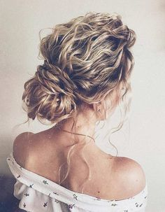 Perfectly Imperfect Updos You'll Love for Your Wedding: Braids look gorgeous for a boho bride who wants to look relaxed but still look stunning!