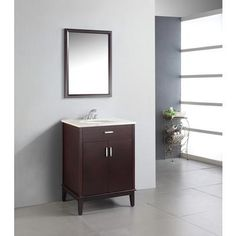 """$598.00  The Simpli Home 24 inch Urban Loft Vanity Collection is defined by its dark espresso brown finish, multi finish chrome pulls & hardware and clean lines and contemporary look. This beautiful assembled vanity provides large storage area with internal shelf behind its 2 doors. The unit also includes white marble top pre-drilled for 4"""" center faucet and one 14"""" x 17"""" oval white vitreous china sink."""