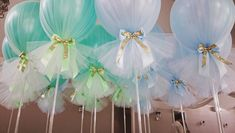 The most amazing colour of our signature tulle balloons today of mint and baby blue with a hint of gold   #originaldesign #bespokeballoons #tulleballoons #christeningballoons #originaldesign