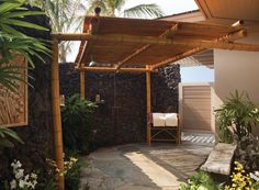 When you arrive at the Four Seasons, you get an aloha, a lei, and—if you booked a first-floor room in the two-story bungalows—an outdoor shower for freshening up.
