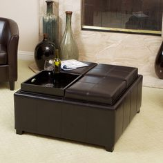 Combine function and style when you place this leather tray top ottoman in your living area. The deep espresso wood is accentuated by the dark brown bonded leather top. Remove the lid to reveal storage space inside. Lids also reverse to form tray tops.