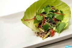 Sang Yoon rised to the top with this quickfire challenge win on Top Chef Masters: spicy pork larb with cabbage and thai chilies. The challenge? Make a dish using the scraps from the Battle of the Sous Chefs sausage challenge. Get the recipe and more at Bravotv.com!