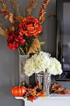 I know this is a fall mantle but I am really liking the flower colors and combo with white hydrangeas.. Way to turn in to a centerpiece?