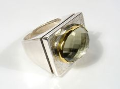 Oval rose cut stone set in 22k gold on silver rectangular by yutal, $420.00
