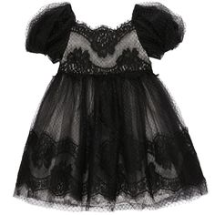 Magnificent black lace and tulle dress. Tulle jupon underneath. Black synthetic lining. Round neckline and short sleeves with elasticated trims. Zip fastening at the back. Dry cleaning only. - £ 614,00
