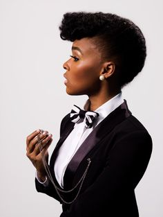 "Janelle Monae - love her whole look.  And the tux as her constant ""work uniform"", slightly altered... And the sci fi mythos she invented for some of her work.  Awesome."