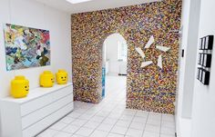 Man builds and entire wall of legos in his house