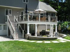deck railings tops are white with white trim/ stained decking
