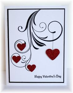 handmade Valentine card from Scrappin' and Stampin' in GJ ... stamped flourish with punched hearts ... luv the clean, graphic look ...