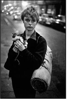 Photo: Bruce Davidson. The photographer encountered this young woman holding a kitten quite by chance. London, 1960.