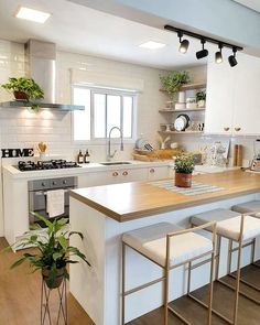 Beautiful all white kitchen with light wood, rose gold handles and natural touch. Beautiful all wh Kitchen Room Design, Modern Kitchen Design, Home Decor Kitchen, Interior Design Kitchen, Kitchen Furniture, Home Kitchens, Interior Plants, All White Kitchen, Cuisines Design