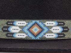 Native American Beaded Hat Band In The Diamond and Feather Pattern with the colors of shimmering Blues, Patina and Fire by LJ Greywolf This Native American Beaded Hat Band with a Diamond and Feather d