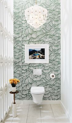 Stunning toilet, with wallpaper and Slim Aarons print