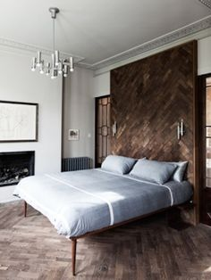 Retrouvius Reclamation and Design Idea in the living room wall (continue the parquet on the wall).