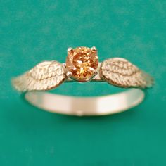 A Snitch engagement ring!!!  Spiffing Jewelry: $100 engagement rings aren't silly, and here's why.