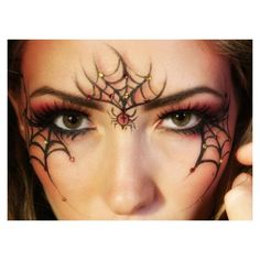 Free Festive Face Paint Design Photos ❤ liked on Polyvore featuring makeup and eyes