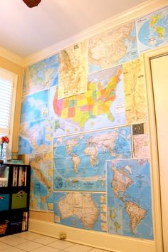These old maps make a great wallpaper for a study or office space. They bring in alot of color that would match any other decor.  What a great idea to reinvent the map!!
