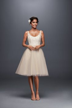 Short and twirly! The short wedding dress works for a city hall wedding or a reception dress! Shop this dress and more wedding dress silhouettes at davidsbridal.com
