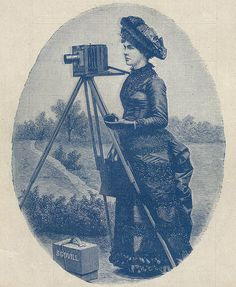 """This fashionably dressed lady amateur, appearing as early as 1883 as a wood engraving in Scovill's catalogue: """"How to Make Photographs"""", advertised their """"Amateur Photographic Requisites""""."""