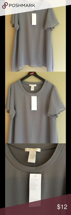 Gorgeous grey Top with pretty flutter sleeves Gorgeous top upper side is polyester material and under shell is like a t SHIRT material. Very cute and comfy. BRAND NEW WITH TAGS. SIZE small. Excellent price. Good quality. Design History Tops Blouses